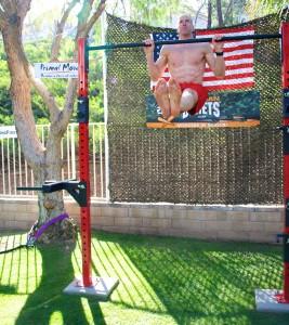 Exercising doing hanging L-sit.