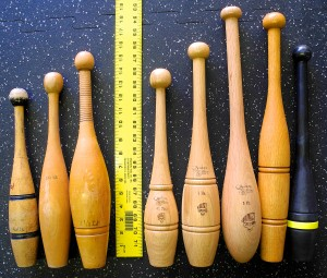 Vintage clubs (L) next to modern 3/4-1 Pound Indian Clubs (R)